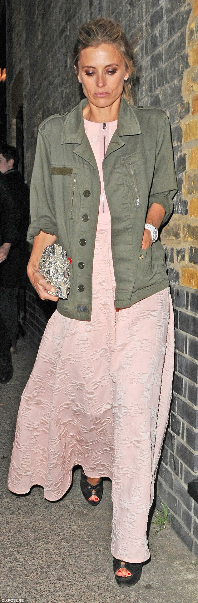All dressed up: Laura Bailey threw a casual green jacket over her dusky pink dress