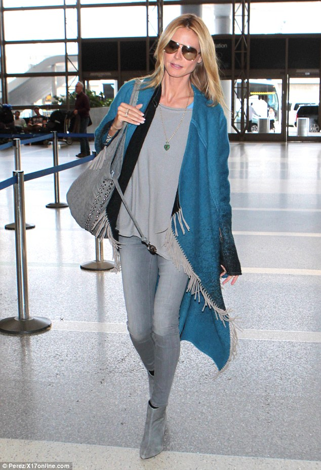 Born to be beautiful: Heidi Klum required little effort to look fabulous as she strolled through LAX ahead of a flight on Thursday
