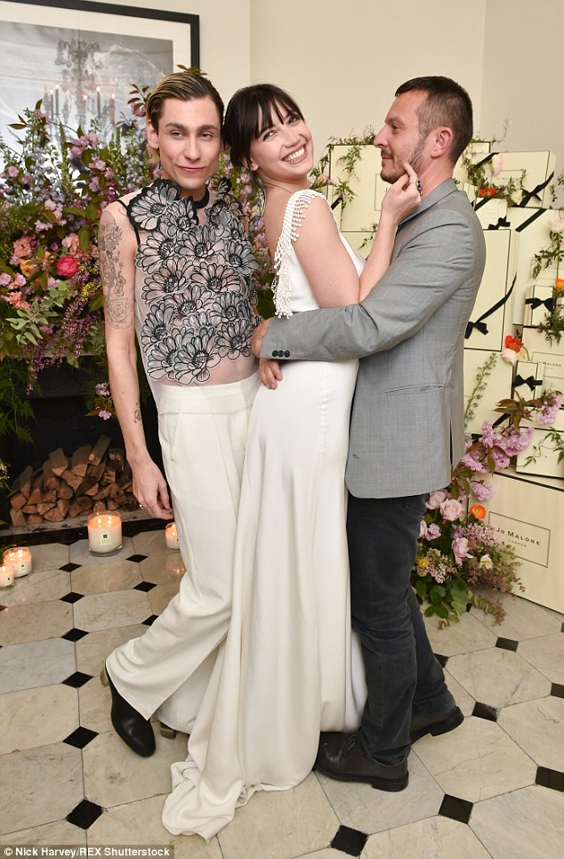 It's a squeeze: Kyle Devolle (left) and Daisy Lowe (centre) complemented each other in white while Jonathan Saunders (right) couldn't keep his eyes off Daisy