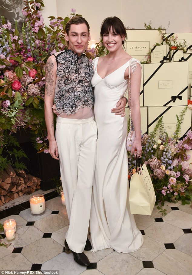 Floral fancies: The duo were surrounded by incredible blooms at the fancy bash