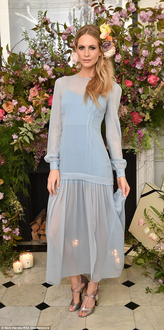 Coming up roses: Poppy Delevingne looked incredible in a flowing blue gown with a semi-sheer skirt, custom-made by Jonathan Saunders for the occasion
