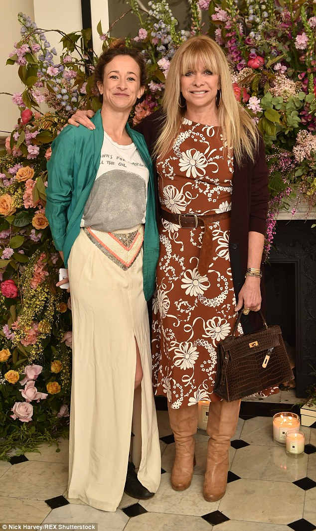 Like mother, like daughter: Jo posed proudly alongside her lookalike daughter Leah Wood