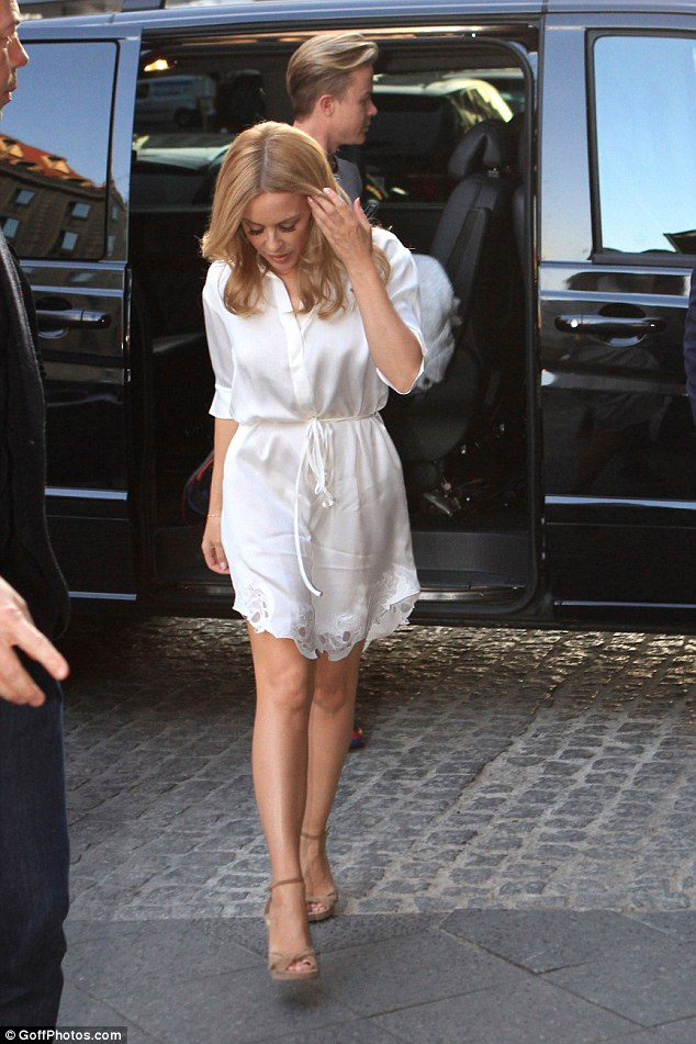 Long day: Kylie was ferried around Berlin in her very own black van complete with entourage