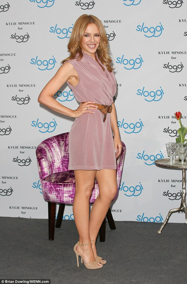 Pint-sized perfection! Kylie  bared her legs in a pastel pink shift dress at the start of the day
