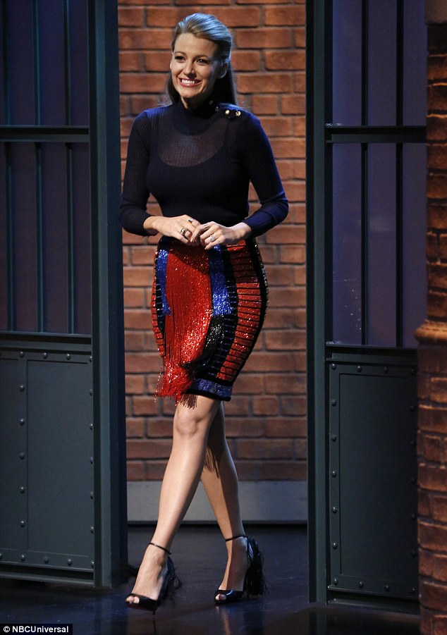 Sparkling: Blake wore another new outfit for her late night TV appearance, opting for a long-sleeved blue sweater with gold buttons on the shoulder and a red and blue sequinned patterned knee-length skirt