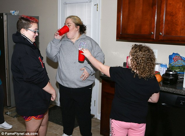 Thirsty work:  Mom and daughters also tried some of the nutritious smoothies that Fett showed them how to make