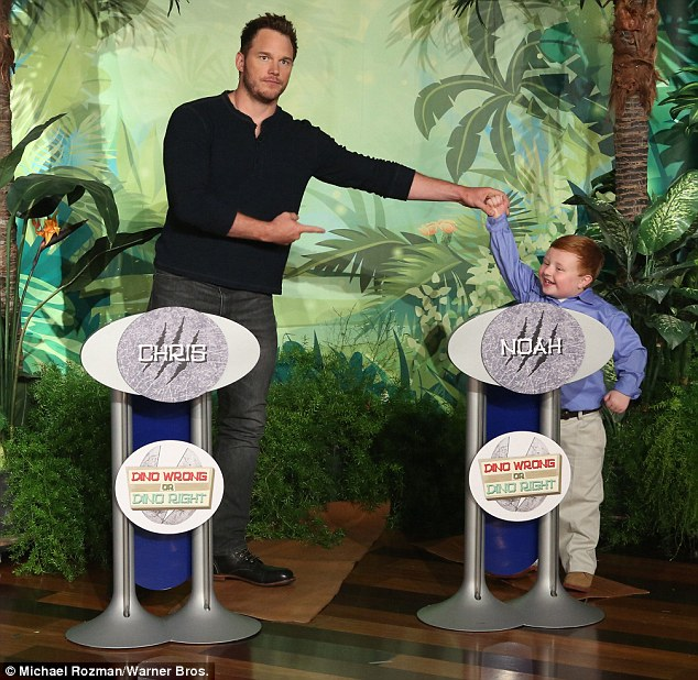 Tough opponent: Chris took onsix-year-old self-described dinosaur expert and viral video star Noah Ritter in a trivia game devised by Ellen called Dino Right Or Dino Wrong