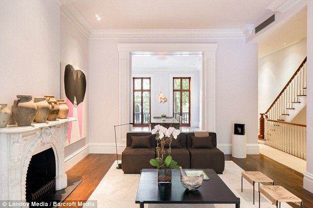 On fire: The property previously cooled off on the market, but perhaps its hand-carved fireplace helped to attract a buyer