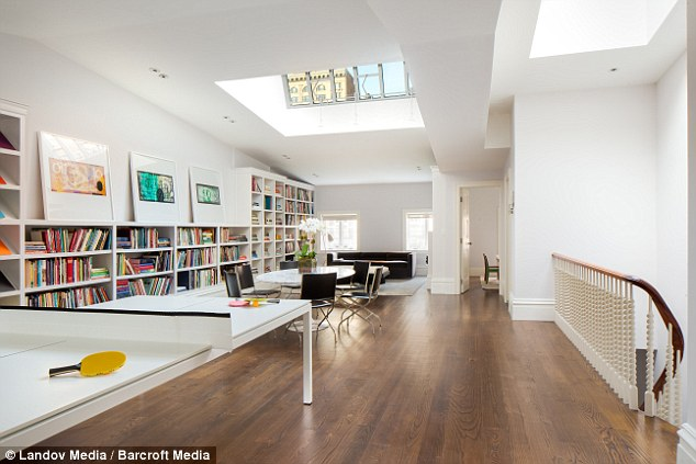 Massive in Manhattan: The property includes five bedrooms, eight bathrooms, gardens and a double parlour with 12.5-foot ceilings and a marble fireplace - seven in total, dining room with floor-to-ceiling double-paned mahogany windows