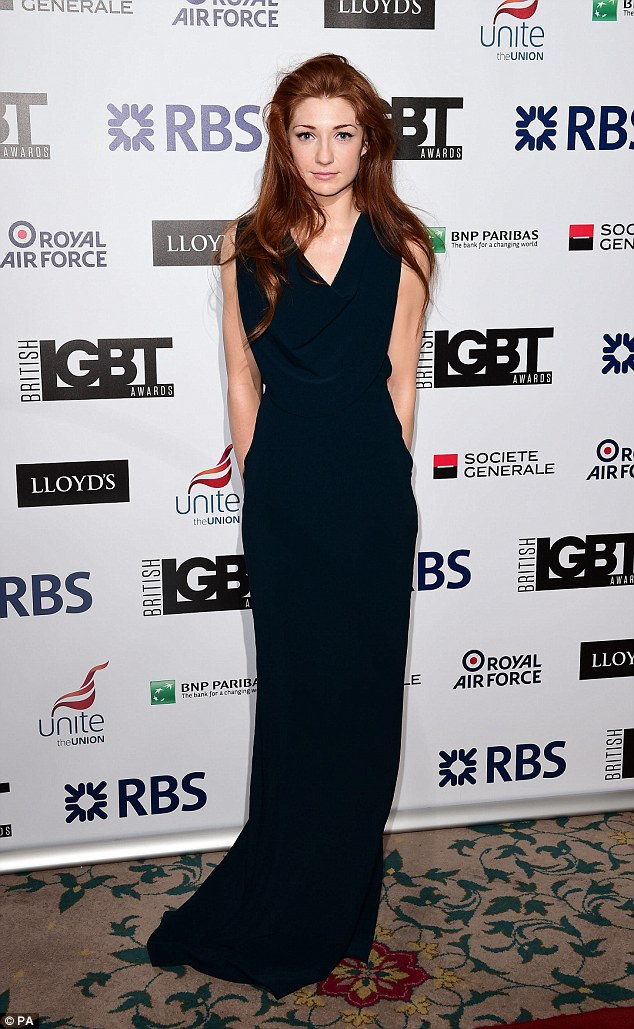 Classy: Nicola wowed fans and turned heads with a navy blue gown which afforded her an elegant aesthetic