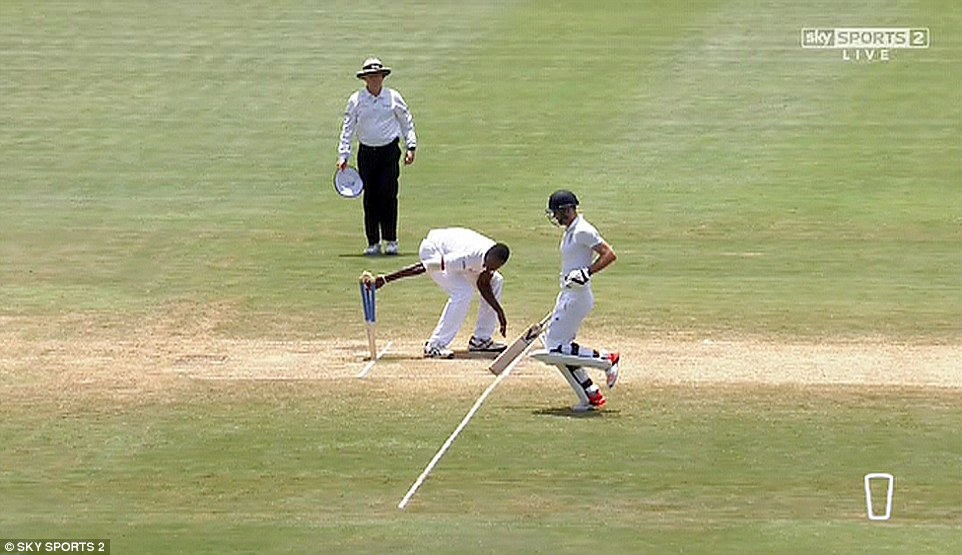 Holder takes the bails off while Anderson makes his way to the crease without sliding his bat on the floor