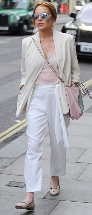 Lindsay Lohan dons spring ensemble with pink cat shoes in London