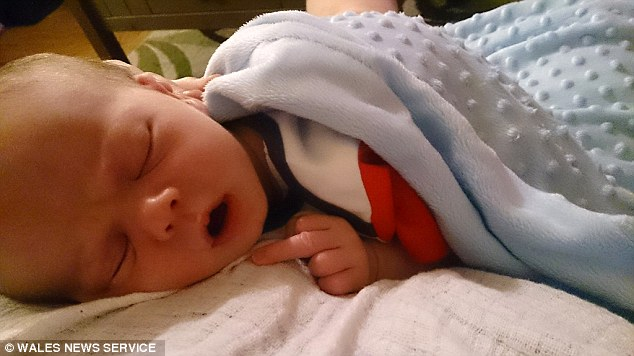 Inquest:Mr Layton recorded an open conclusion and said Efan's death could not be explained on pathological grounds - but a pathologistsaid it was typical of Sudden Unexpected Infant Death or 'cot death'