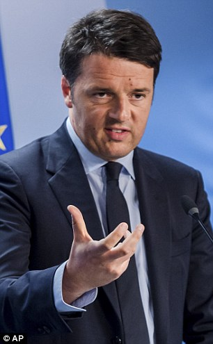 Italian Prime Minister Matteo Renzi speaks during a media conference after an emergency EU summit at the EU Council building in Brussels
