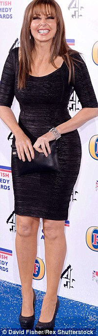 Carol Vorderman likes to show off her curves but her pins lack definition