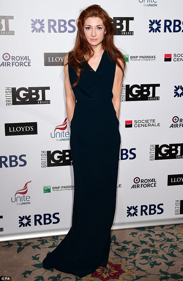 Simply does it: Nicola Roberts wears an elegant dark blue floor-length gown for the event