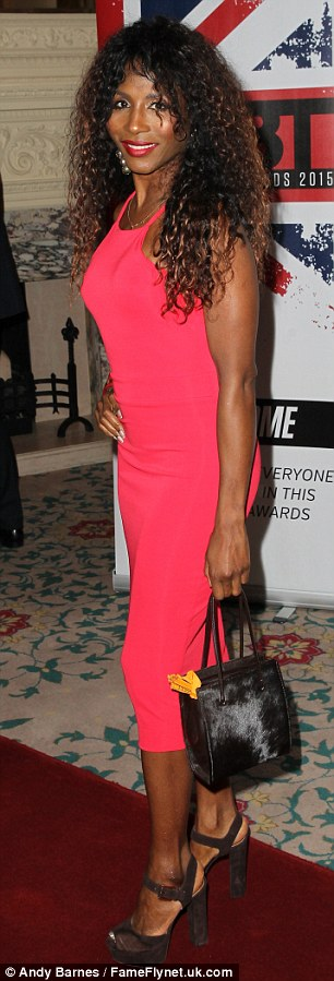 Hot pink! Sinnita showed off her slim figure in a bright dress with suede heels