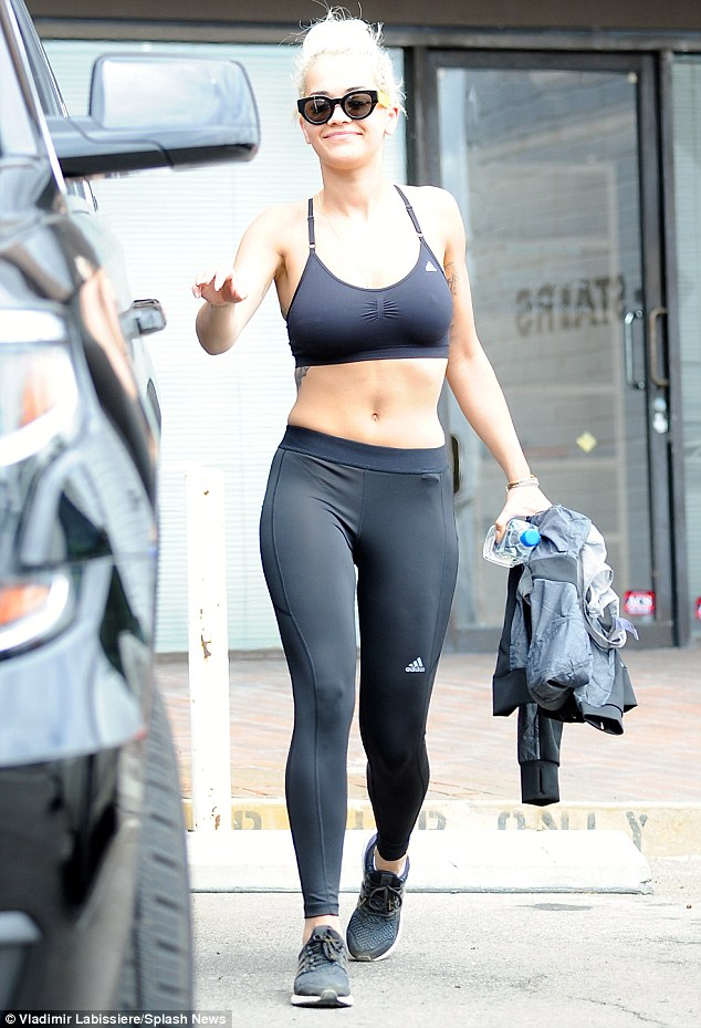 Bottled bronze: Rita Ora was spotted going for a spray tan in West Hollywood, California, on Friday