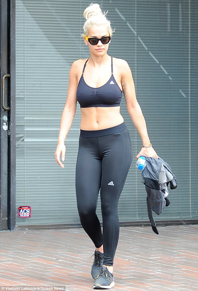 Fit: The 24-year-old chart-topper showed off her athletic physique in a black bralet with matching leggings