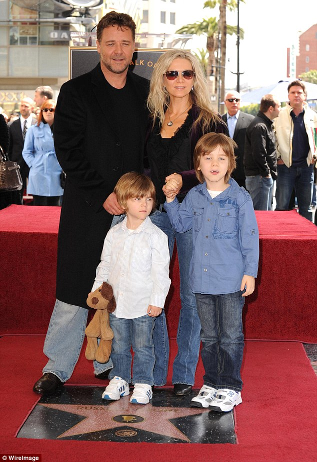 Close family: The couple have remained on good terms  for the sake of their sons Charlie (right) and Tennyson (left) and have even been on holiday together as a family since their split (Pictured at Russell's Hollywood Walk of Fame induction in 2010)