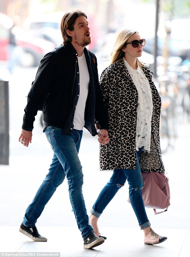 No letting go: The pair walked hand in hand as they headed into the Radio 1 studios in London