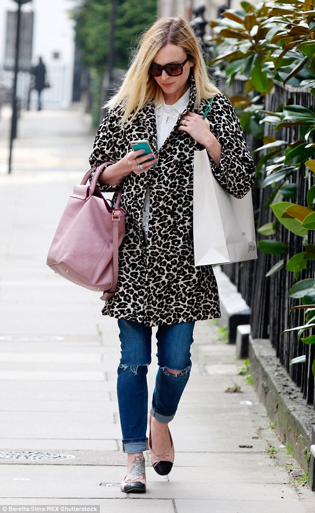 Maternity chic! Fearne looked super stylish in a leopard coat, laser cut blouse, distressed jeans and pumps