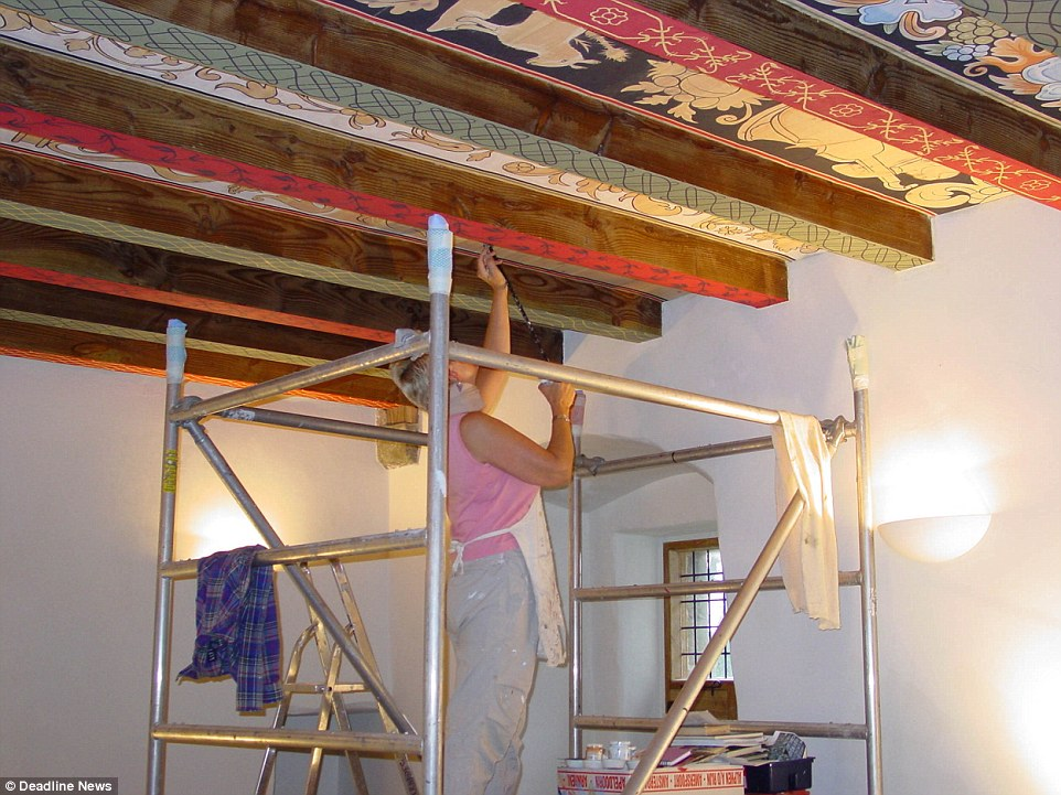 A decorator paints the ceiling during the castle's restoration. Mrs Brennan says the newly refurbished property would be a fabulous holiday home