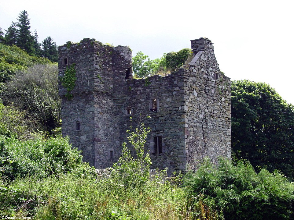 The crumbling ruins of Barholm Castle in Dumfries and Galloway, when it was bought by Mr and Mrs Brennan for £65,000 in 1997