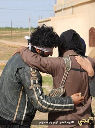Strange: The group of executioners made a display of hugging the blindfolded couple and telling them they were forgiven of their 'sins', before pummeling them to death with hundreds of fist-sized rocks