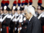 Italian President Sergio Mattarella reviews the honor guard during a ceremony to mark Italy's Liberation day, in Rome Saturday, April 25, 2015. Italy is cele...