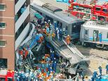 An aerial view of a commuter train that jumped its tracks on a tight bend and ploughed into a residental tower in Amagasaki city, Hyogo prefecture, seen on A...