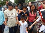 Children of Filipina drug convict and death row prisoner Mary Jane Veloso, Mark Darren, 6 (lower front C), Mark Daniel, 12 (C), along with other relatives ar...