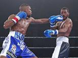 Sweden's Badou Jack (L) connects with Anthony Dirrell of the US during their super middleweight fight, at the UIC Pavilion in Chicago, Illinois, on April 24,...