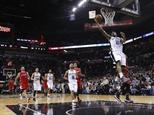 Kawhi Leonard of the San Antonio Spurs slam dunks against the Los Angeles Clippers during Game Three of the Western Conference quarterfinals of the 2015 NBA ...