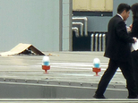 FILE - In this Wednesday, April 22, 2015 file photo, a small drone covered with cardboard, is seen on the roof of Prime Minister Shinzo Abe's official reside...