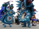 Neke Nixon, Queen of the Black Mohawk Mardi Gras Indians, parades with Sage Mavens, 6, at the Jazz and Heritage Festival in New Orleans, Friday, April 24, 20...