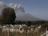 Plumes of smoke and ash billow from the Calbuco volcano as seen from Puerto Varas, Chile, Friday, April 24, 2015. The volcano, which had been dormant for mor...