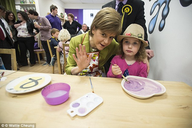 Ms Sturgeon was pictured with three-year-old Kitty MacDonald and SNP Candidate for Glasgow South Stewart McDonald during a visit to Glazed, a ceramic painting studio in the city