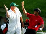 Tiger Woods and his caddie, Steve Williams, celebrate after Woods chipped in for birdie on the 16th hole during the final round of The Masters at the Augusta National Golf Club on April 10, 2005 in Augusta, Georgia.   (Photo by Harry How/Getty Images)