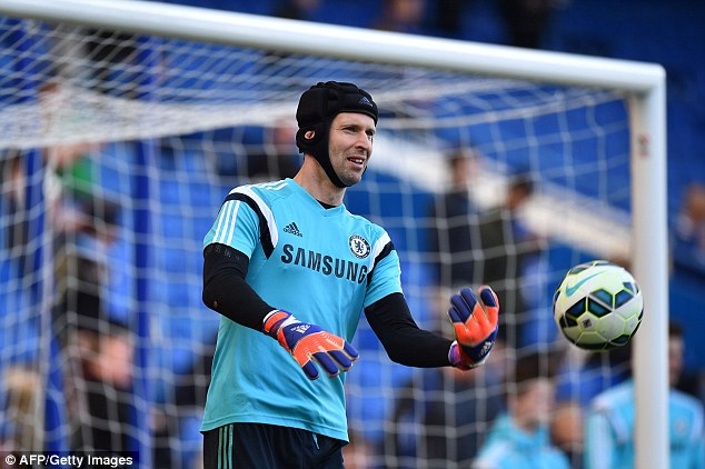 Chelsea goalkeeper Petr Cech warms up before Saturday's Premier League clash against Manchester United