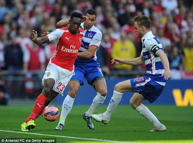 Danny Welbeck (left) looks to evade the challenge of Reading's Hal Robson-Kanu (centre) and Alex Pearce