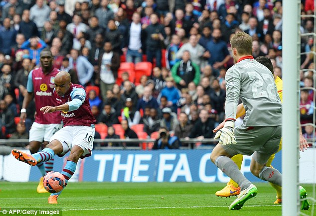 Delph slots the ball past Liverpool goalkeeper Simon Mignolet in Villa's 2-1 victory at Wembley