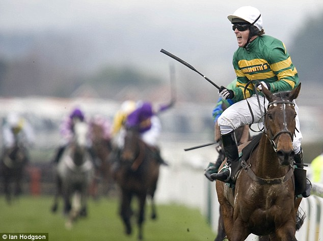 McCoy celebrates aboard Grand National winner Don't Push It at Aintree racecourse in 2013