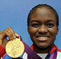 File photo dated 09-08-2012 of Great Britain's Nicola Adams with her gold medal won in the boxing 51kg category at Team GB house in London. PRESS ASSOCIATION Photo. Issue date: Friday April 17, 2015. Nicola Adams has no intention of following her former Great Britain team-mate Natasha Jonas into retirement as she focuses on becoming a double Olympic gold medallist in Rio next year. See PA story BOXING Adams. Photo credit should read Tim Ireland/PA Wire.