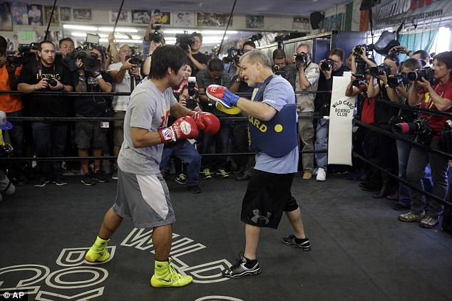 The Filipino has been training hard with his coach Freddie Roach ahead of the $300million mega-fight