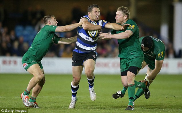 Bath flanker Sam Burgess is tackled by Exiles winger Alex Lewington (left) and Tom Court