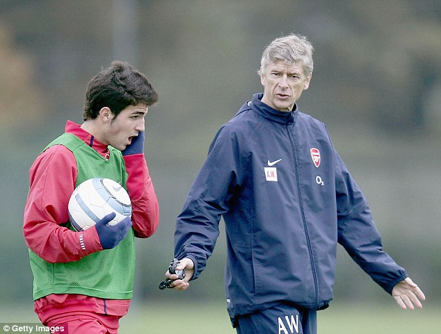 Arsenal boss Arsene Wenger speaks to a young Fabregas after snatching him away from Barcelona in 2004