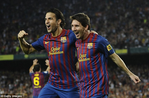 Lionel Messi (right) celebrates with Fabregas after scoring his first goal for Barcelona in 2011