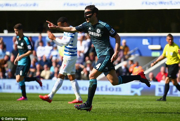 Fabregas celebrates scoring the only goal against local rivals QPR at Loftus Road earlier this month