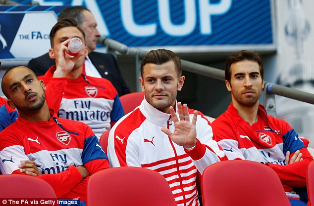 Jack Wilshere (centre) was on the bench for Arsenal's FA Cup semi-final against Reading